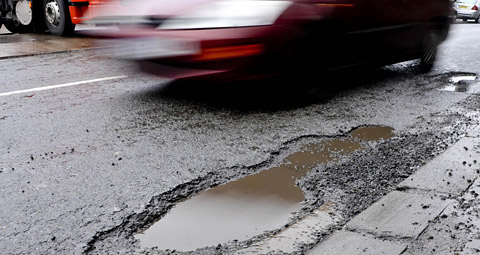 Politicians have clashed over the standard of repairs to potholes