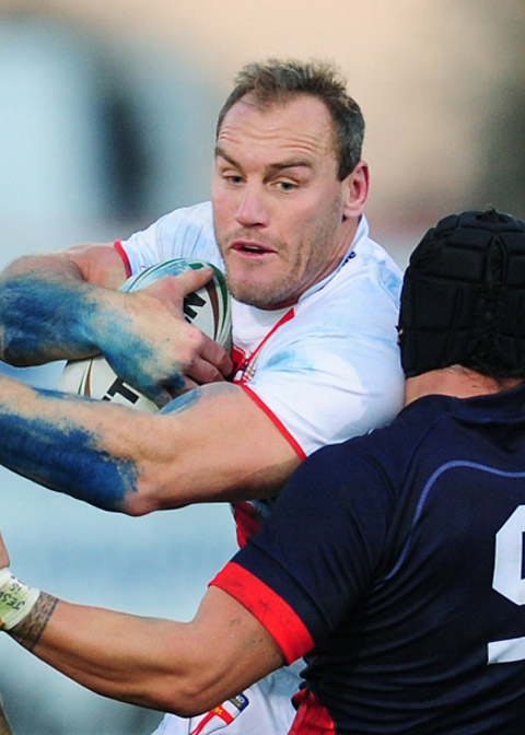 Hull captain Gareth Ellis forces his way through the France defence while playing for England last year
