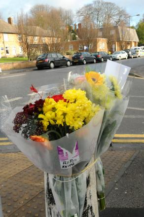 Floral tributes for Keith Wright at the corner of Fairfax Court and Acomb Road
