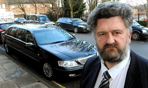 Philip Taylor, of Co-op Funeralcare, with the hearse which was pelted with snowballs