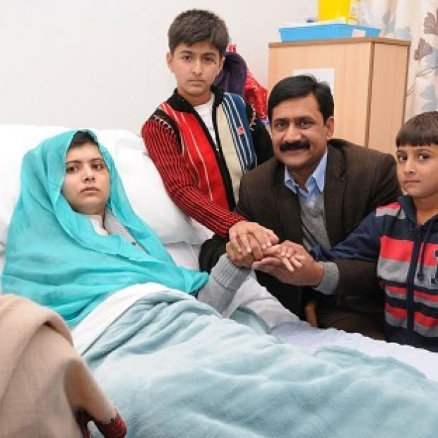 Malala Yousufzai, left, underwent successful cranial reconstruction and cochlear implantation procedures (Queen Elizabeth Hospital Birmingham/PA)