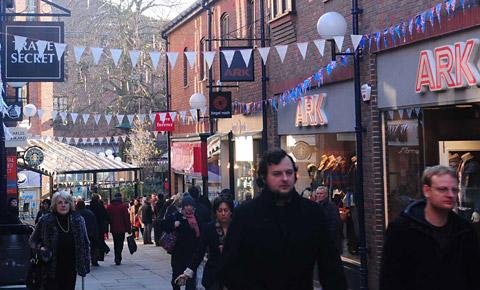 Shoppers walk past the record-breaking bunting in the Coppergate Centre, York