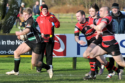 York RUFC's Eddie Bradshaw goes on the run against Huddersfield YMCA