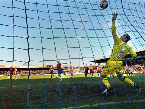 York City's Jason Walker smashes his penalty past Morecambe 'keeper Barry Roche