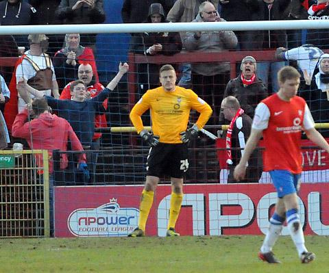 York City goalkeeper Michael Ingham is heckled by the visiting Morecambe supporters after missing his kick and allowing Kevin Ellison to score in  an empty net and give his side a 2-1 lead.
