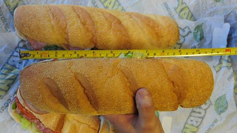 The different-sized Subway sandwiches are compared, with one clearly failing to measure up