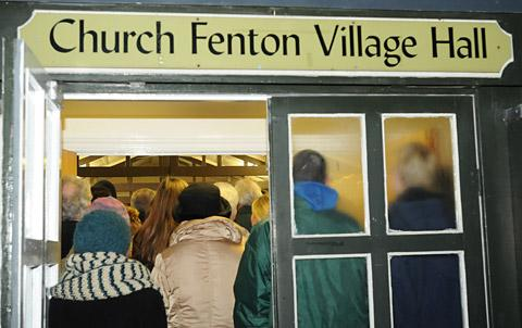 Anxious villagers attend the meeting to find out more about the impact the proposed high-speed rail link would have on their community