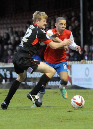 York City's Curtis Obeng in action, right, against Morecambe