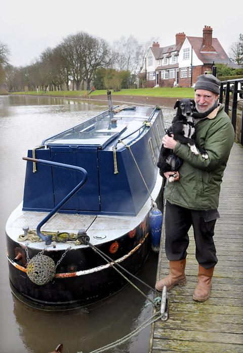 Tenant Bob Gaskell with his dog Rags and his narrowboat with Naburn Lock House in the background