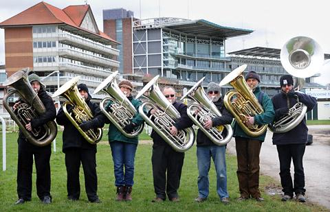 Tuba players, from left, Craig Brown, Richard Wilton, Kate Lock, Peter Scott, John Stewart, Chris Jilbert and Darryl Rayner get in some practice ahead of the world-record attempt at York Racecourse