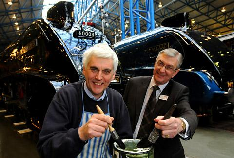 Friends of the National Railway Museum, from left, Russ Rollings and Christopher Jones with their paint brushes as the Dwight D Eisenhower meets its sister locomotive, The Mallard, for the first time in the Great Hall