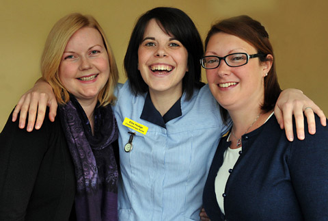 Chemotherapy nurse Ellie Hodge hugs ex-patients Kathryn Cook, left, and Rebecca Hastie, who have  nominated her for the Patient's Choice Award