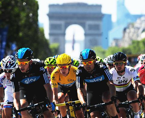 Bradley Wiggins, centre, rides with Sky team mates Mark Cavendish, right, Chris Froome, left, and Bernhard Eisel during Stage 20 of the Tour de France between Brambouillet and Paris, last year
