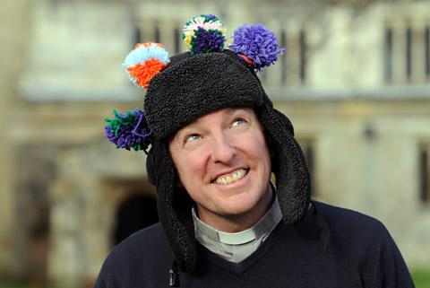The vicar of St Wilfrid's Church in Brayton, the Reverend Pete Watson, wears his bobble hat to raise money for Age UK