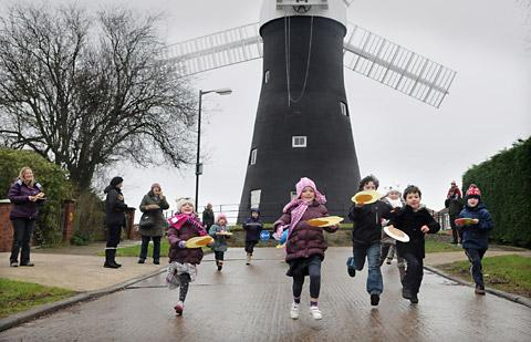 Pancake races at Holgate Windmill Pancake Day