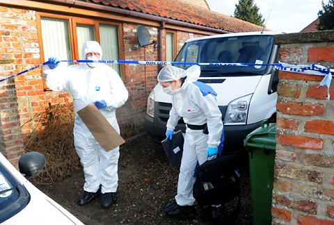 Forensic officers outside Whisker Cottage in Full Sutton