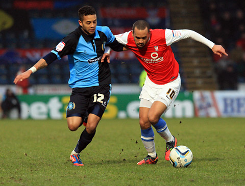 Fit-again City  forward Ashley Chambers, right, tries to shrug off Wycombe's Bruno Andrade