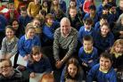 BBC journalist Harry Gration meets the children at Tang Hall Primary School