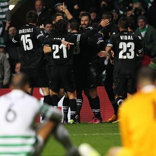 Mirko Vucinic, centre, scored the third goal for Juventus at Parkhead