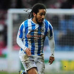 Sean Scannell scored the winner to put Huddersfield through to the fifth round