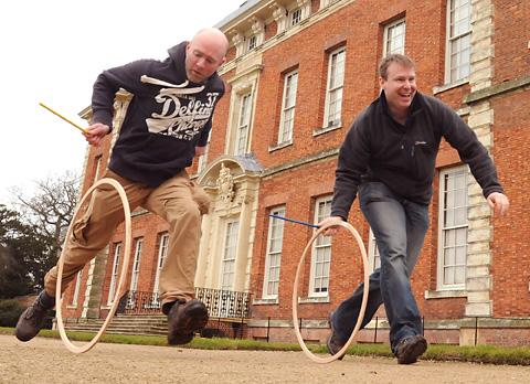 Rob Brown and Steve Williams get in some practice with hoops and sticks