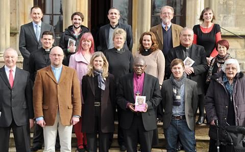 The Archbishop of York, Dr John Sentamu, poses with some of the people included in his new book John Sentamu's Faith Stories, during its launch at Bishopthorpe Palace