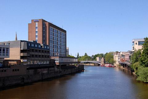 The Park Inn by Radisson York, on the right of the River Ouse, dominates the skyline
