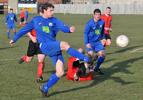 Pickering Town's Liam Shepherd opens the scoring against Maltby