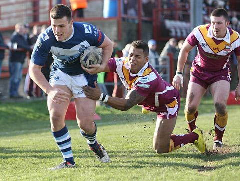 Centre Joe Arundel escapes the clutches of Batley's Greg Johnson to score York City Knights' only try in a 42-4 Championship defeat at Mount Pleasant. Picture: Gordon Clayton