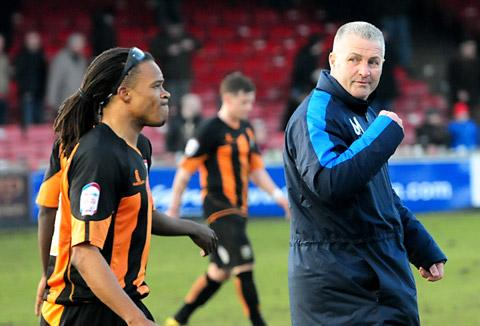 Barnet  player-boss Edgar Davids, far left, and York City counterpart Gary Mills share a word after the final whistle of Saturday's npower League Two clash at Bootham Crescent, which the visitors won 2-1