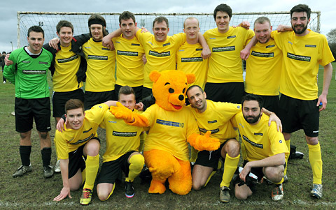 James Hooton, who plays Sam Dingle in ITV soap Emmerdale, snuggles up to Lenny Bear, watched by Luke Roskell, front left, and the Emmerdale team who played a charity match for St Leonard's Hospice