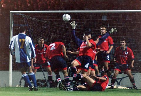 Andy Warrington crowns his York City debut with a free-kick save to foil Manchester United's Eric Cantona