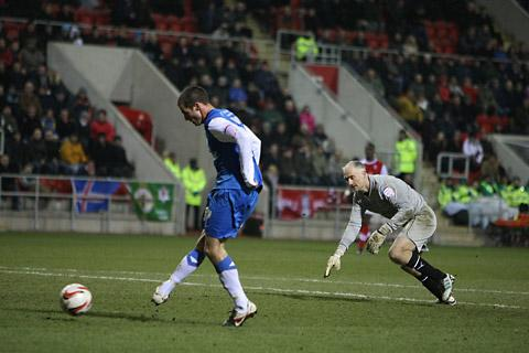 York City's Matty  Blair rounds Rotherham United  goalkeeper Andy Warrington to put  his side in front at the New York Stadium. Picture: Gordon Clayton