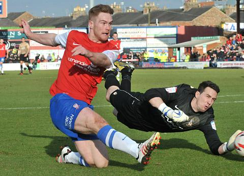York City striker Jason Walker rounds Bradford 'keeper Jon McLaughlin but sees his shot cleared off the line