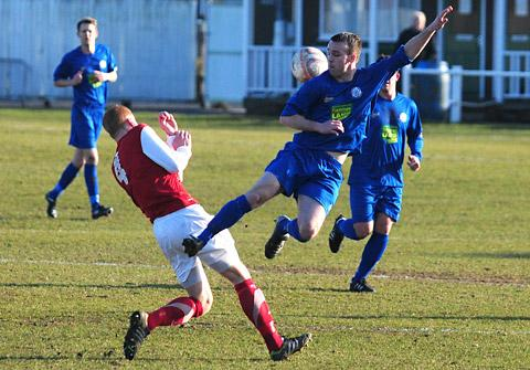 Pickering Town's Liam Shepherd, right, in high-kicking action with Thackley's Matt Morgan during the Pikes' 2-1 win