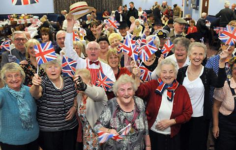 Flag-waving  revellers enjoy the Best Of British 1940s dance night at the Tramways Club in York