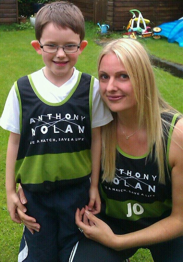 Cancer survivor Jo Buckton, 38, with her son Jake, six