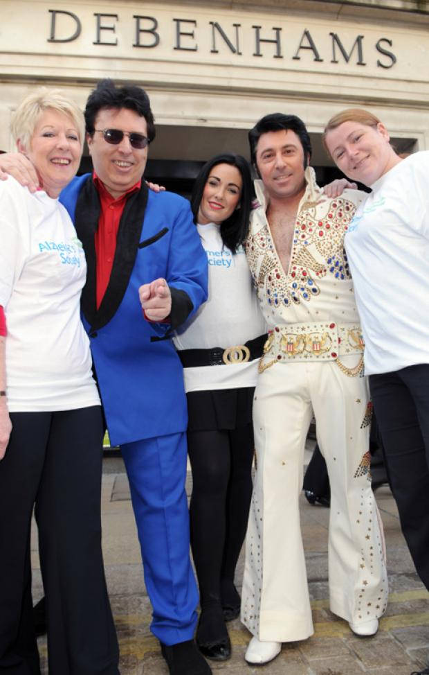 Elvis acts Eddie Vee, left, and Dean Holland get ready for their Alzheimer's Society fundraising event with Debenhams staff, from left, Kay Strickland, Lauren Dougall and Debbie Dunning