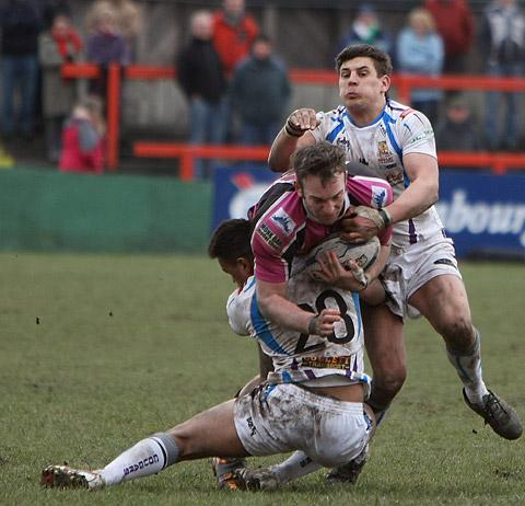 York City Knights' Matt Nicholson is halted by Keighley Cougars pair Charlie Martin and James Feather. Picture: Gordon Clayton