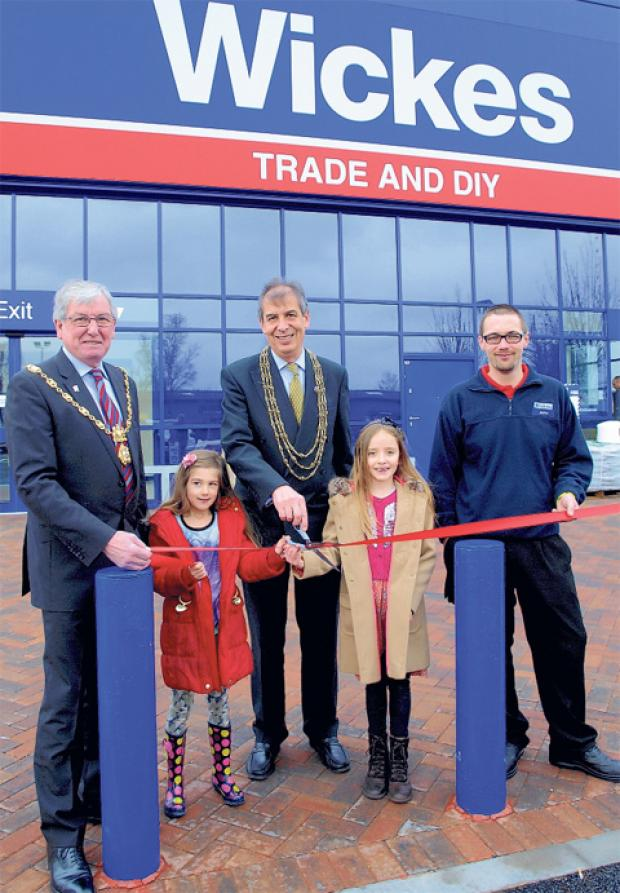 Zara Ritchie, front right, and Grace Bell officially open the new Wickes store assisted by, from left, the Sheriff of York Coun Paul Firth, the Lord Mayor of York, Coun Keith Hyman and store manager John Tickle