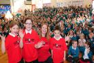 Emma Dixon, Scarlet Robson and Thomas Brook with Estelle O'Hara, head teacher of Poppleton Ousebank Primary School, taking part in the Sing Up day