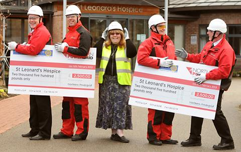 Annie Keogh, corporate fundraiser at St Leonard's Hospice, receives a £5,000 donation from Northern Powergrid staff, from left, Neil Bond, Richard Atkinson, Paul Raywood and Nick Bateman