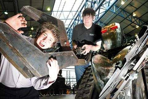 Alan Young at the controls of Goliath from Robots Live as he gets to grips with Sam Potts of the National Railway Museum ahead of the event at the weekend