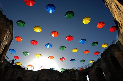 Umbrellas suspended over Clifford's Tower as part of an art installation called Umbrella Sky