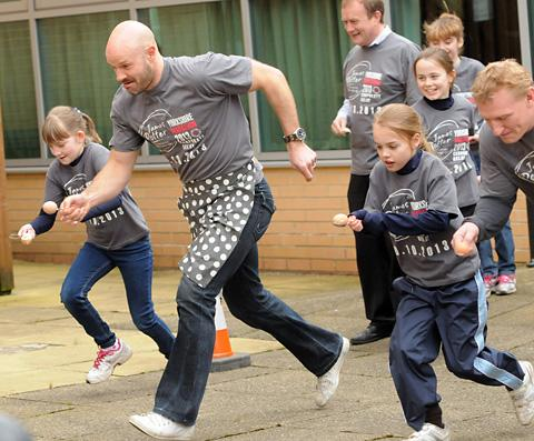 Former Leeds United and England footballer and Celebrity Masterchef finalist Danny Mills helping to launch the Yorkshire Marathon corporate relay by taking part in an egg-and-spoon race with children from St Mary's School at Topcliffe