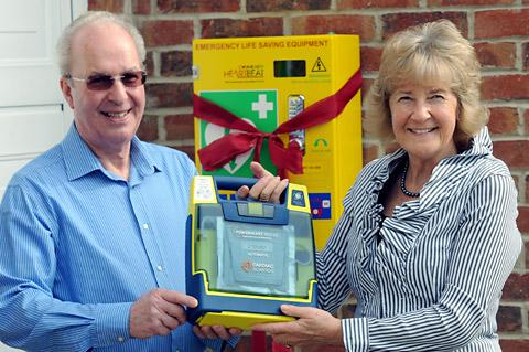 Bill and Liz Heath with the defibrillator unit at their home in Claxton