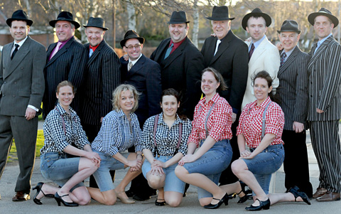 The cast of Guys And Dolls line up for a pre-show photocall