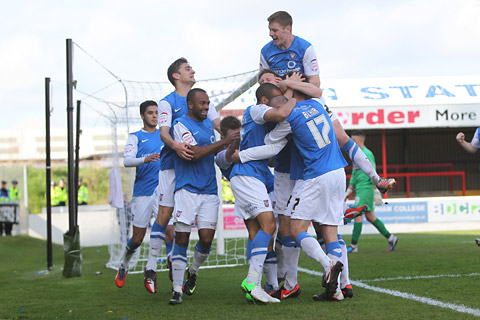 York City's players mob captain Chris Smith after his winner at Dagenham. Picture: TGS Photos