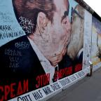 A satirical mural depicting Communist dictators Brezhnev and Honecker kissing at the East Side Gallery, located on the longest part of the wall that is still standing