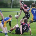 New Earswick U16s' Josh Phillips gets out an offload in the thrilling decider against York Acorn U16s